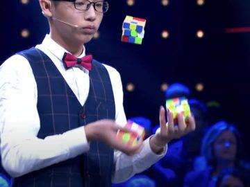 This Kid Solved 3 Rubik's Cubes While Juggling For A World Record!